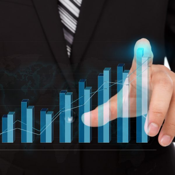 businessman-touching-the-tip-of-a-bar-chart